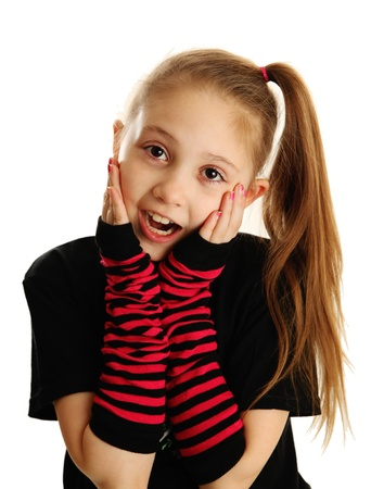 Cute young girl isolated on a white background, wearing pirate punk gloves with surprised face expression photo