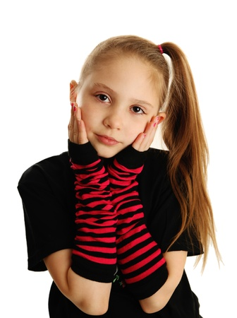 Cute young girl isolated on a white background, wearing pirate punk gloves photo