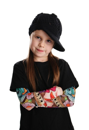 Cute young preschool age girl isolated on a white background, wearing tattoo punk clothes and rock star photo