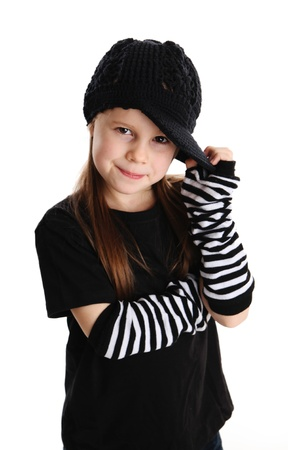 Cute young preschool age girl isolated on a white background, wearing punk clothes and rock star photo