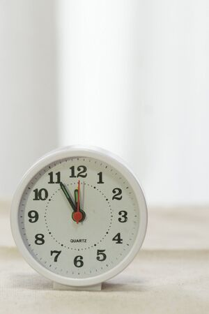 Clock 5 minutes before 12 pm