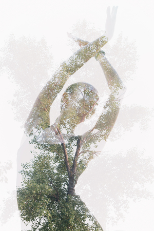 Double exposure portrait of dancing woman combined with photograph of tree Stock Photo