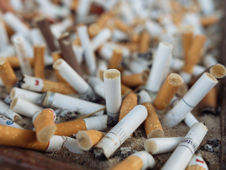 Cigarette butts stacked. Smoking kills. Bad for health Imagens