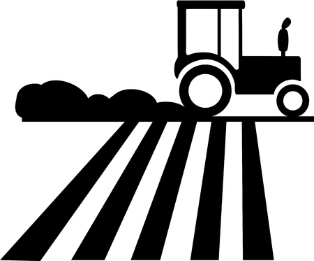Silhouette of a tractor running on the field which causes dust.