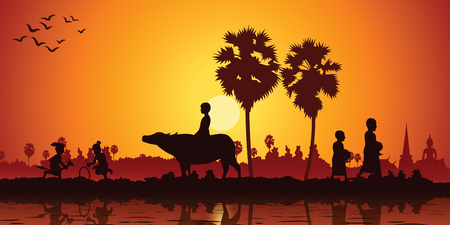 country life of Asia children play banana horse ride buffalo while monk receive food on sunrise time,silhoutte style