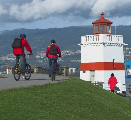 stanley: cyclists on the Stanley park seawall Stock Photo