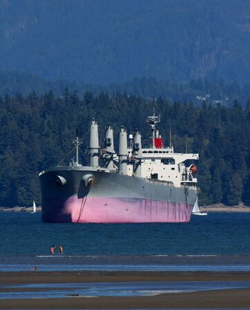 Freighter at anchor in Vancouver harbour photo