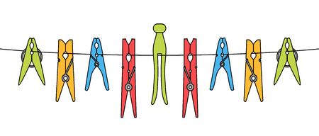 Diverse kleding of waspennen die op het touw geïsoleerd zijn