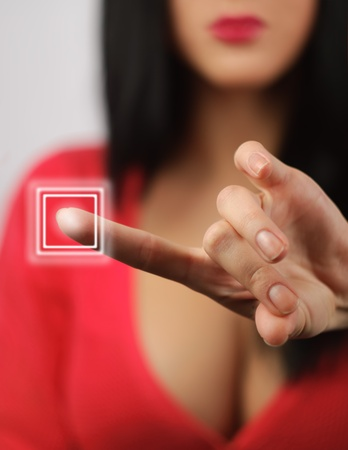 interested girl presses the touch screen buttons Фото со стока