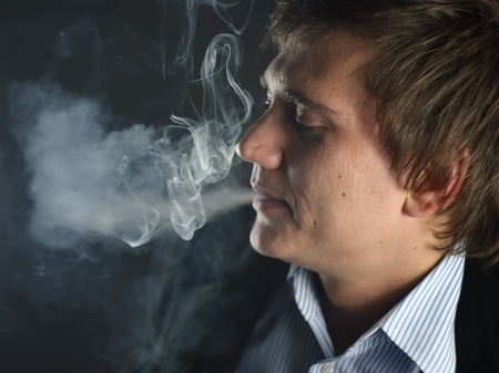 portrait of the smoking person photo