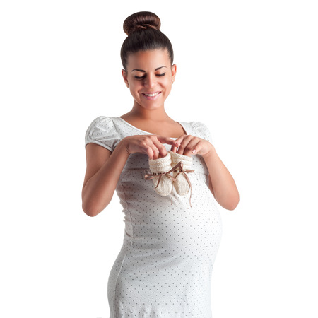 young beautiful pregnant woman posing isolated on white background Stock Photo