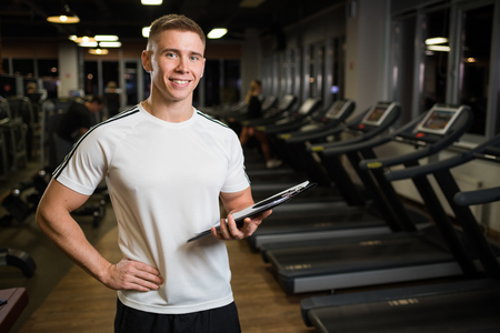 Smiling trainer in his hands. Stock Photo