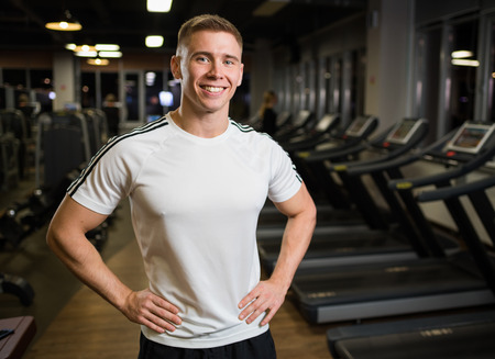 Personal trainer stands with a smile