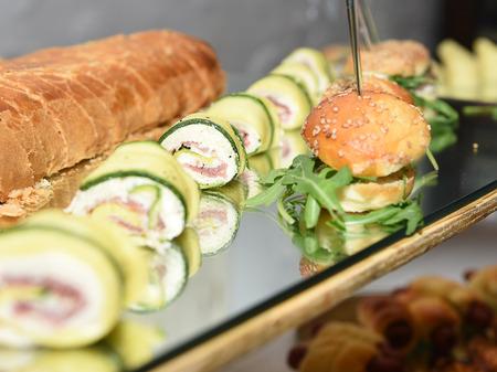 gastronome: zucchini slices with mozzarella and ham with bread and rolls