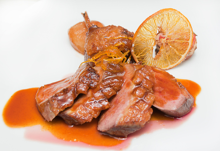 meat orange delicious plate with a tasty orange flavored cream