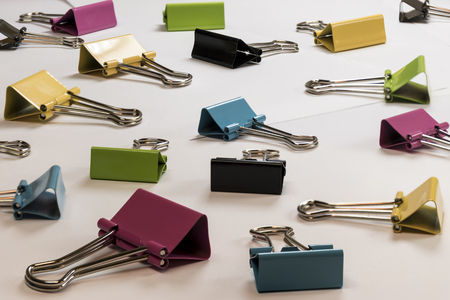 metal fastener: Detail of colored binder clips. Photographed in studio