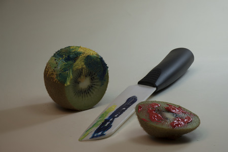 Detail of kiwi painted in full color. Photographed in studio Stock Photo