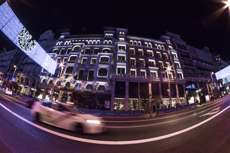 Fisheye. Christmas lights in the streets of the Madrid City. Gran Via street Editorial