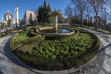 Fish-eye view 180 of a fountain in the Retiro park in Madrid city, Spain