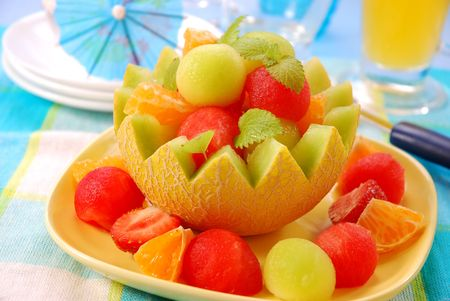 fresh melon`s balls as dessert in bowl made from melon