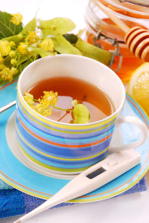 linden tea: healthy linden tea in blue cup with honey and lemon Stock Photo