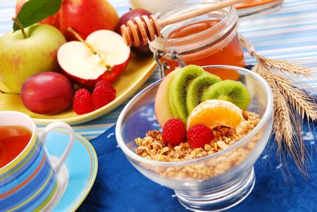 bowl of muesli with fresh fruits as diet breakfast