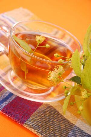 healthy linden tea on orange background Stock Photo - 5689492