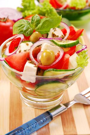bowl of greek salad with feta cheese photo