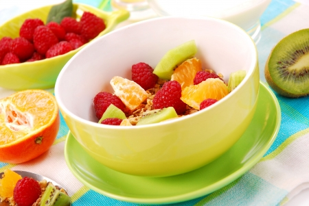 cereal bowl: bowl of muesli with fresh fruits as diet food