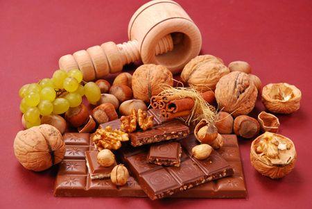 dark and milk chocolate bars with nuts and raisins photo