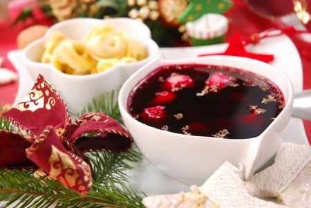 beet: red borscht with mushroom ravioli as traditional christmas eve soup Stock Photo
