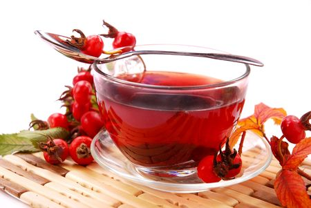 cup of rosehip tea izolated on white