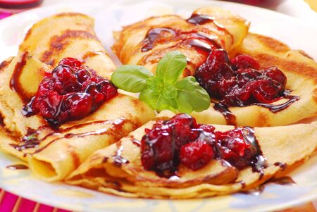 pancakes on plate with sweet cherry confiture