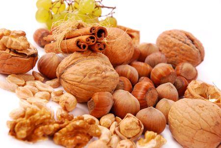 hazelnuts and walnuts  isolated on white photo