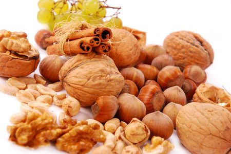hazelnuts and walnuts  isolated on white photo