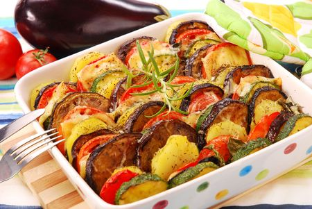 vegetable casserole with aubergine,zucchini,tomato,potato and cheese Stock Photo