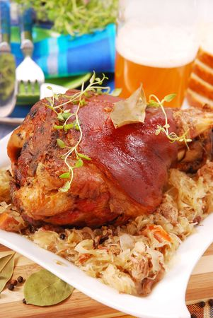 pork knuckle baked with beer and sauerkraut photo