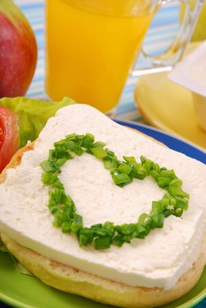 sandwich with cottage cheese and arranged chives in the shape of a heart photo