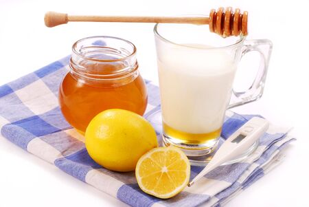remedy: milk with honey in glass as natural medicine