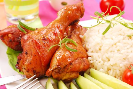 baked chicken legs with rice and vegetables