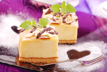 cheese cake with almonds on purple plate with love symbols