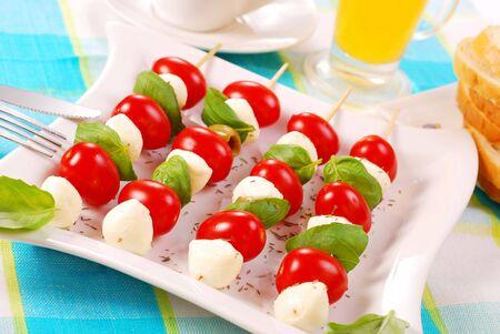 shashlik with mozzarella balls,cherry tomatoes and olives photo