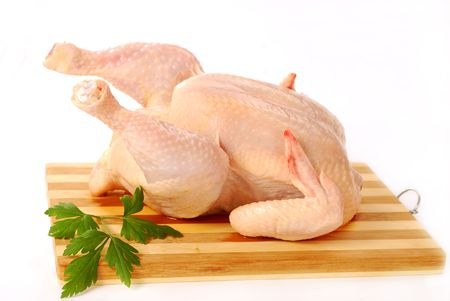 raw whole chicken isolated on white
