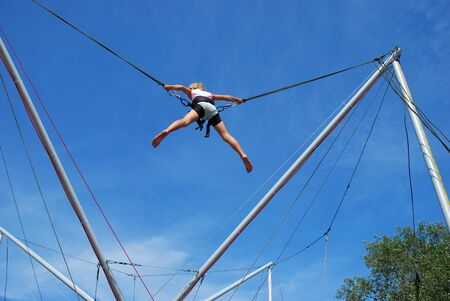 young girl having fun  on rope jumping photo