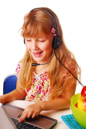 young girl with headphone learning with laptop  photo