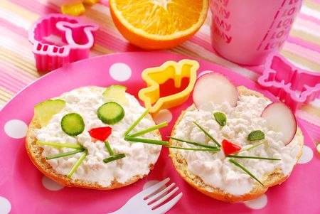 funny food: breakfast with cottage cheese for child with cat and mouse shape sandwich Stock Photo