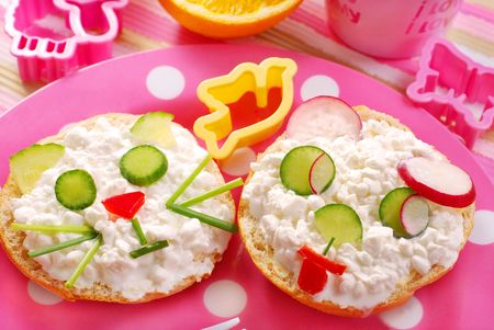 breakfast with cottage cheese for child with cat and puppy shape sandwich photo