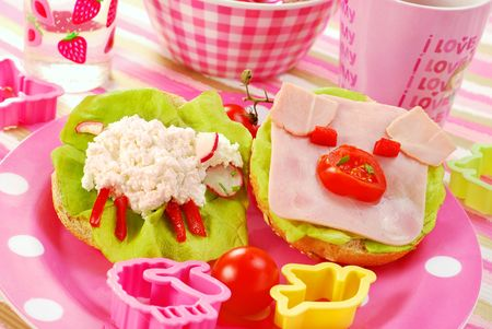 breakfast with cottage cheese for child with sheep and pig shape sandwich photo