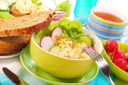 breakfast eggs: diet breakfast with bowl of  egg and cheese spread Stock Photo