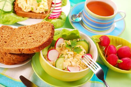diet breakfast with bowl of  egg and cheese spread photo